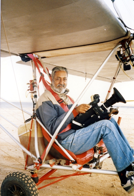 Mohinder filming at the Amboseli Game Park from a microlite which has the slowest stalling speed with an open view all round except the frame. Photo by Africapix