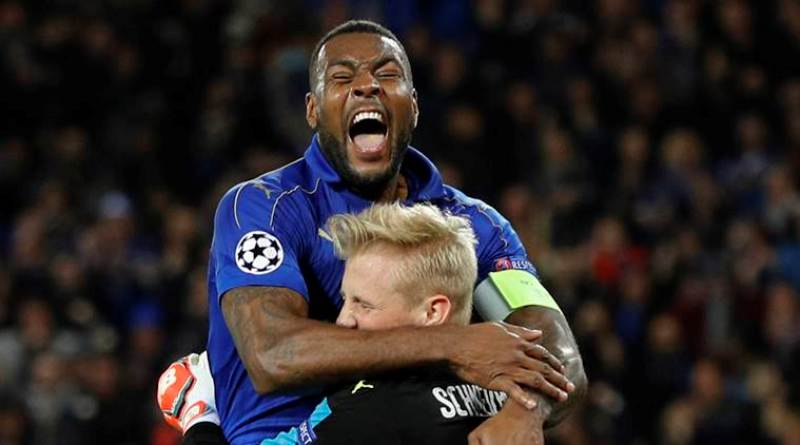 Britain Soccer Football - Leicester City v Sevilla - UEFA Champions League Round of 16 Second Leg - King Power Stadium, Leicester, England - 14/3/17 Leicester City's Kasper Schmeichel celebrates with Wes Morgan after saving a penalty Reuters / Darren Staples Livepic