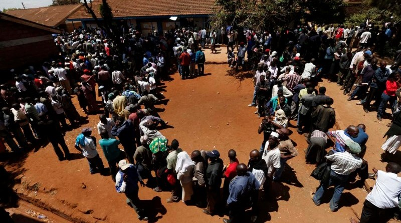 Kenyans wait in line to cast their vote  in the Kibera slum in the capital Nairobi March 4, 2013. Polling stations opened up to Kenyans on Monday for a tense presidential election that will test whether the east African nation can repair its damaged reputation after the tribal blood-letting that followed a 2007 poll. REUTERS/Steve Crisp (KENYA - Tags: POLITICS ELECTIONS) ORG XMIT: SEC08